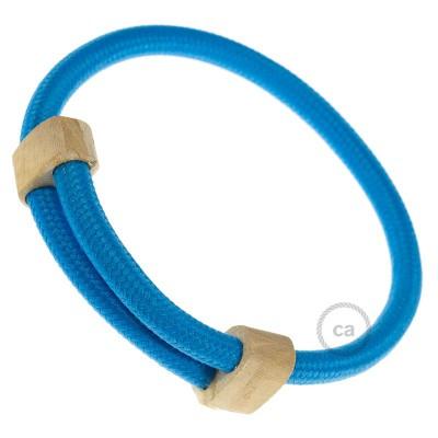 Creative-Bracelet i turkost viskos RM11. Skjutbar fästanordning i trä. Tillverkad i Italien.